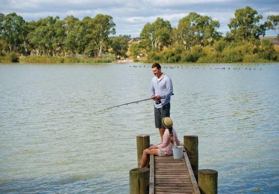 Couple fishing on jetty
