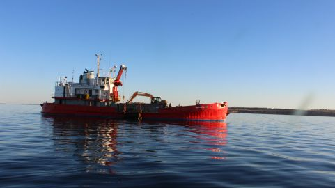 Construction vessel <i>MPV Andrew Wilson</i> out at the reef site near Rogues Point constructing the reef